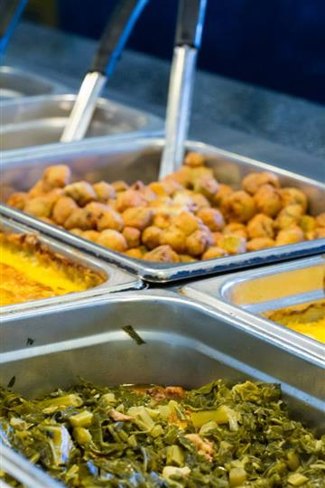 fried okra and collards in buffet trays