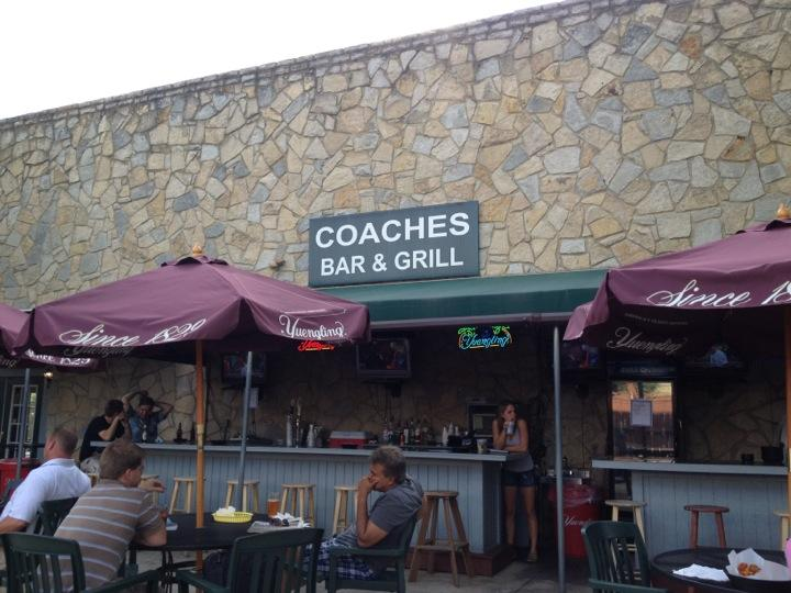 Coaches Bar and Grill front patio with a bar and stools