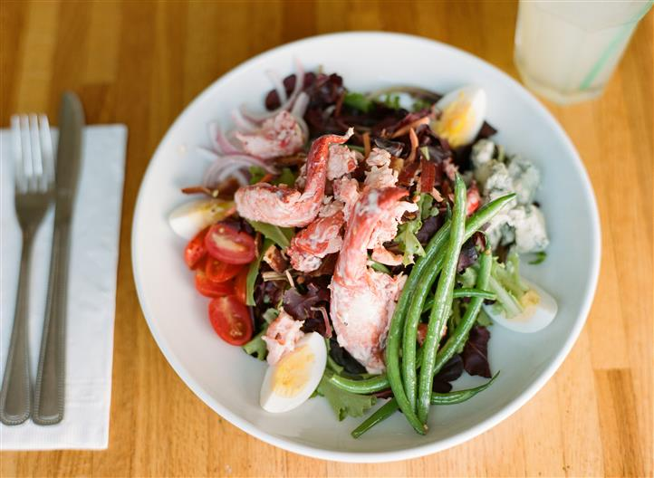 large salad with lobster pieces, asparagus, eggs and tomatoes