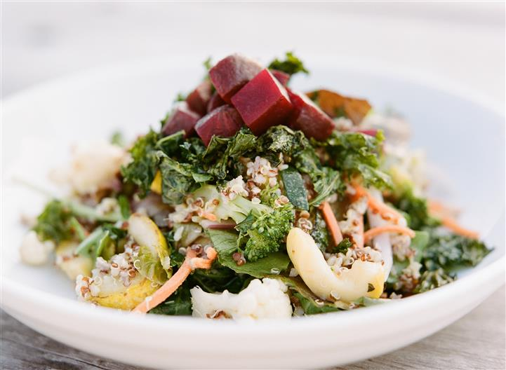 large salad with vegetables, beets and cheese