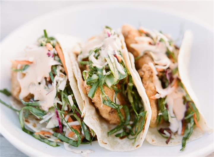 three chicken tacos with coleslaw