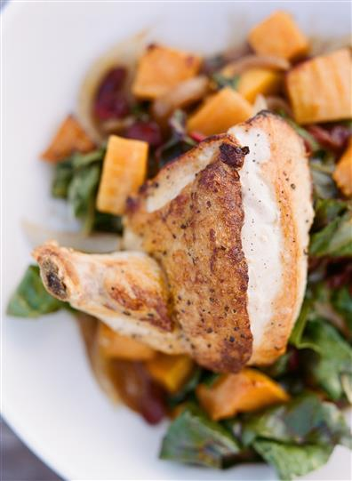 chicken thigh on a large salad