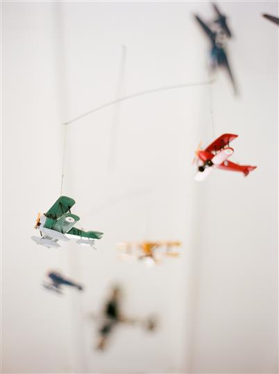 model airplanes hanging from a ceiling