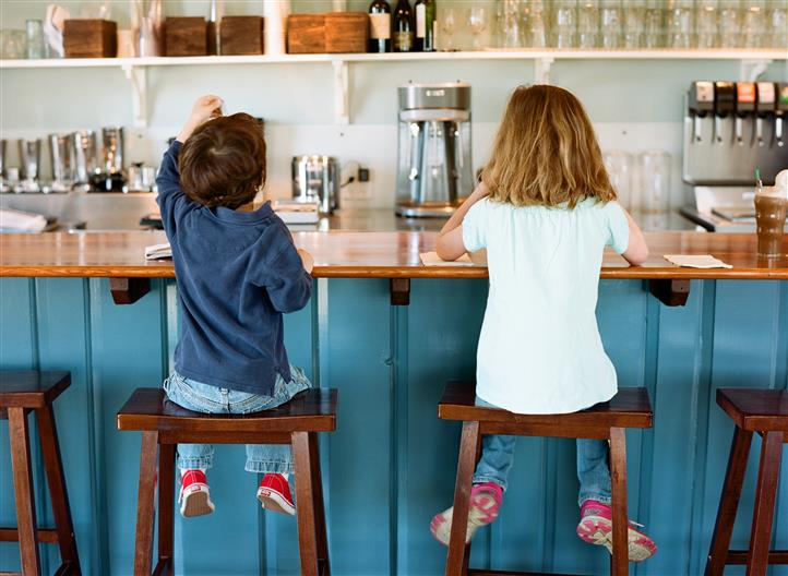 two children eating at the counter
