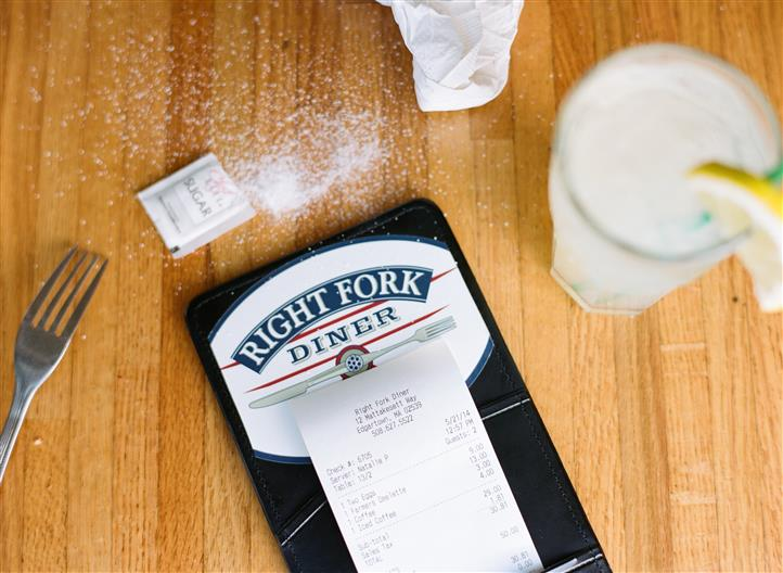 right fork diner menu on a wooden table with drinks