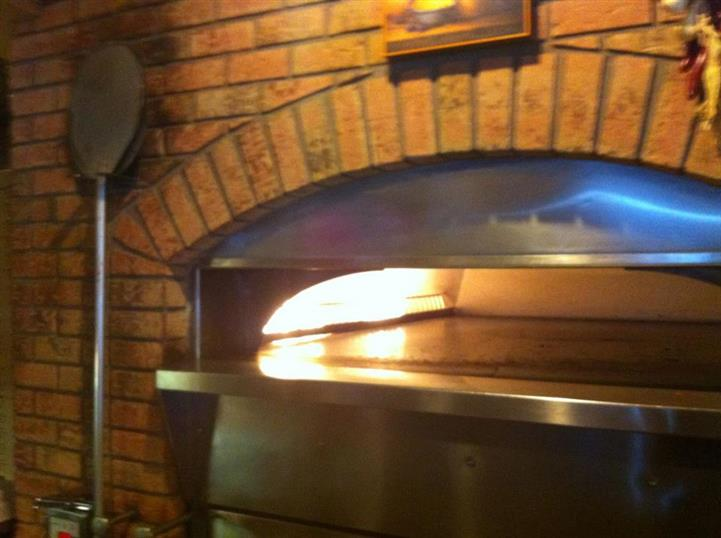 Brick oven in use