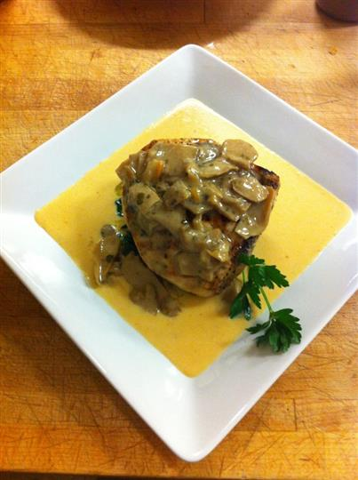 grilled swordfish fillet over a lobster bisque fondue with garlic sautéed spinach and porcini mushrooms!