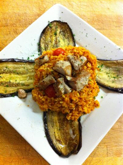 Chicken bites with orzo baked in tomato sauce and served with big slices of baked eggplant
