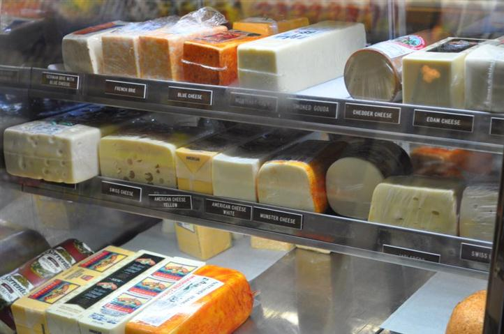 Assorted Cheese behind display