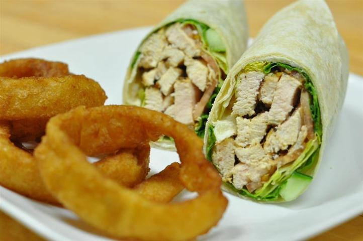 Grilled chicken wrap with onion rings