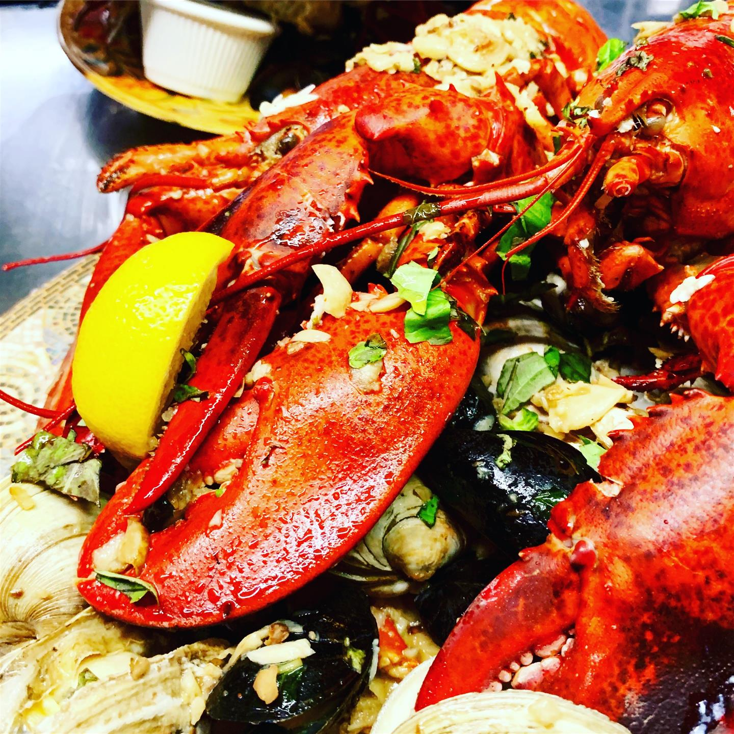 The Clam Bake.  Our 11/4 whole lobster, crab legs, steamers, mussels, clams and shrimp are steamed in our light butter and garlic sauce. Served with corn on the cob