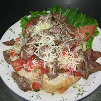 Beef with cheese, lettuce, and tomato