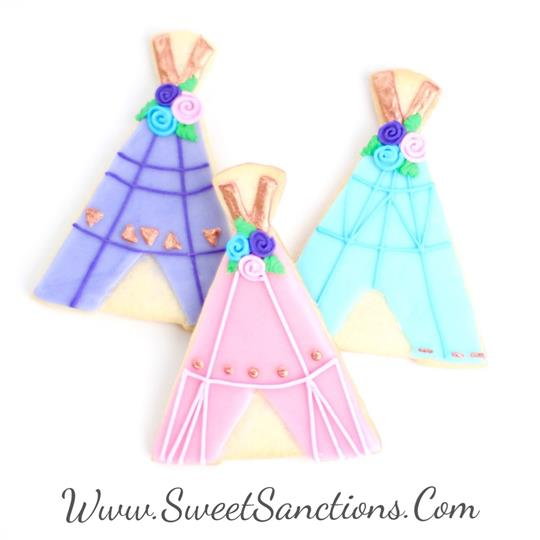 3 cookies decorated as teepees with frosting