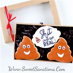 "2 poop emoji cookies with a sign between them that says ""shit just got real"""