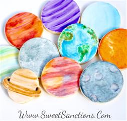 10 circle shaped cookies designed to look like planets