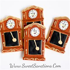 4 cookies designed as grandfather clocks with frosting