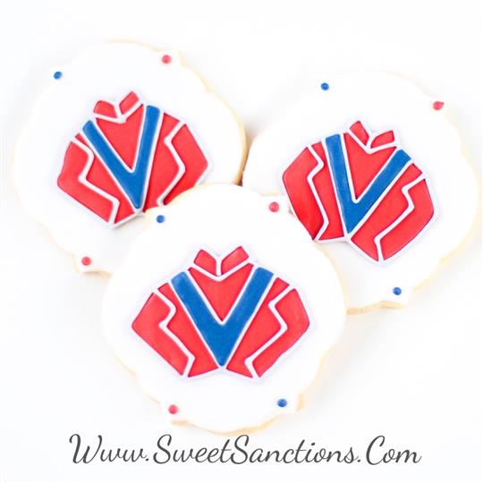 three cookies with a Jockey's uniform on them