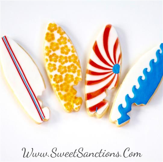 four cookies shaped as surfboards