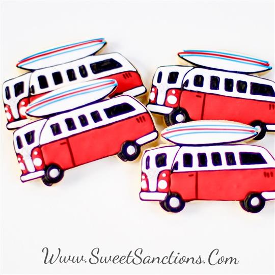 four cookies that are shaped and painted to look like a VW van with a surfboard on top