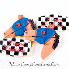 4 cookies, two shaped and painted as horse heads and the other two paited as race flags