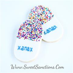 "oval shaped cookies with sprinkles on one side and the word ""xanax"" on the other"