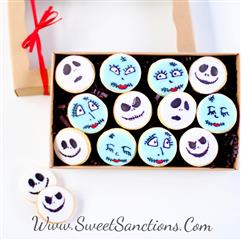 15 cookies decorated as jack and sally skellington