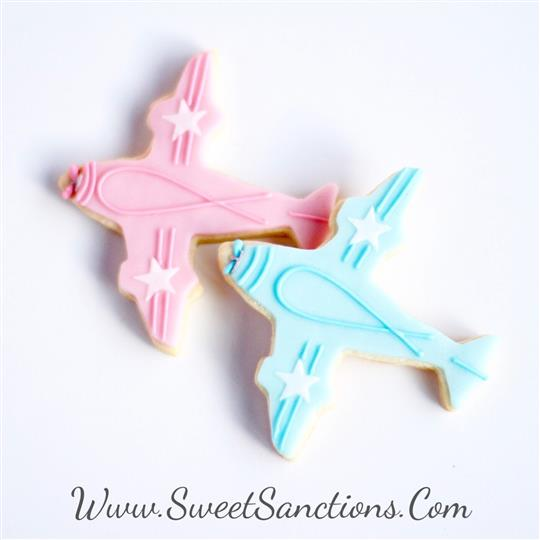 two cookies shaped like planes