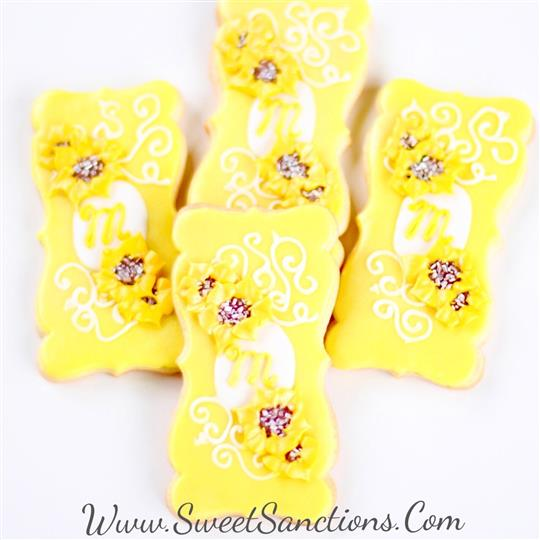 4 rectangle cookies with frosting sunflowers