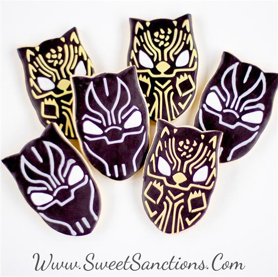 6 cookies shaped and decorated as the black panther mask