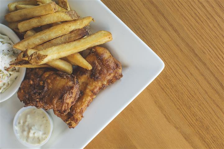 wings and fries on a plate