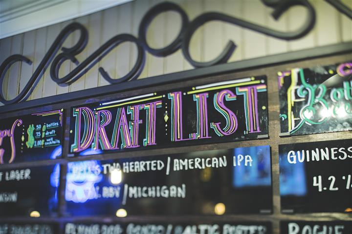 sign above bar that reads draft list