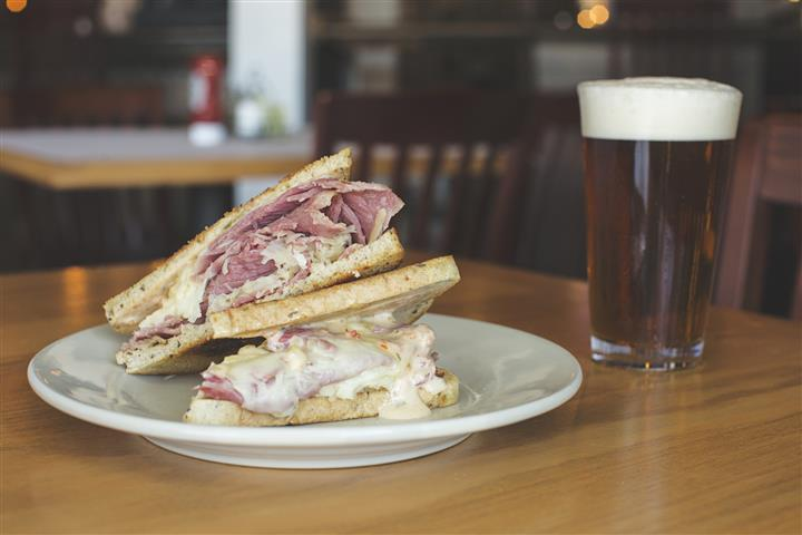 reuben sandwich with a beer