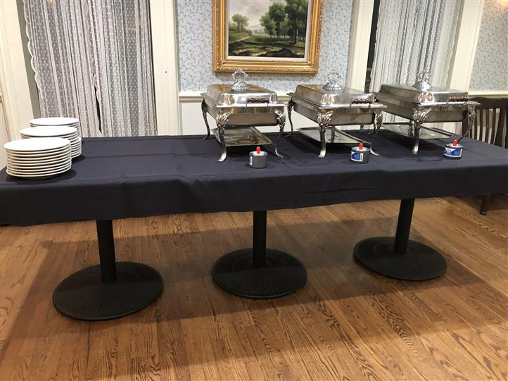 A catering table with a black table cloth