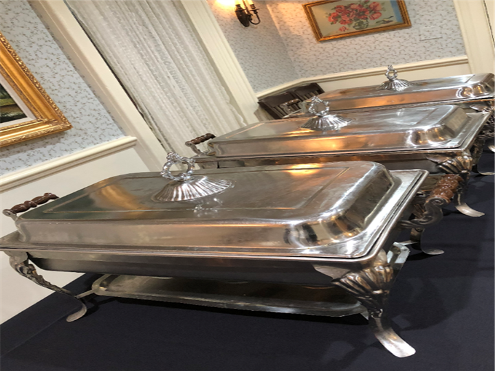 Catering tins filled with food on a table
