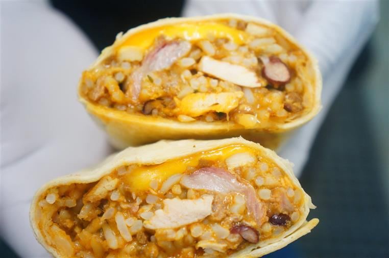 wrap made with chicken, rice, beans, and cheese.