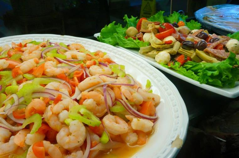 Tray of cold shrimp salad and cold antipasto