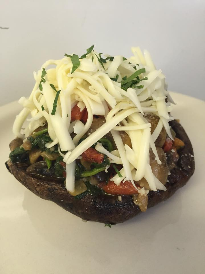 portabella mushroom stuffed with broccoli rabe, roasted red peppers and mushrooms then topped with mozzarella cheese