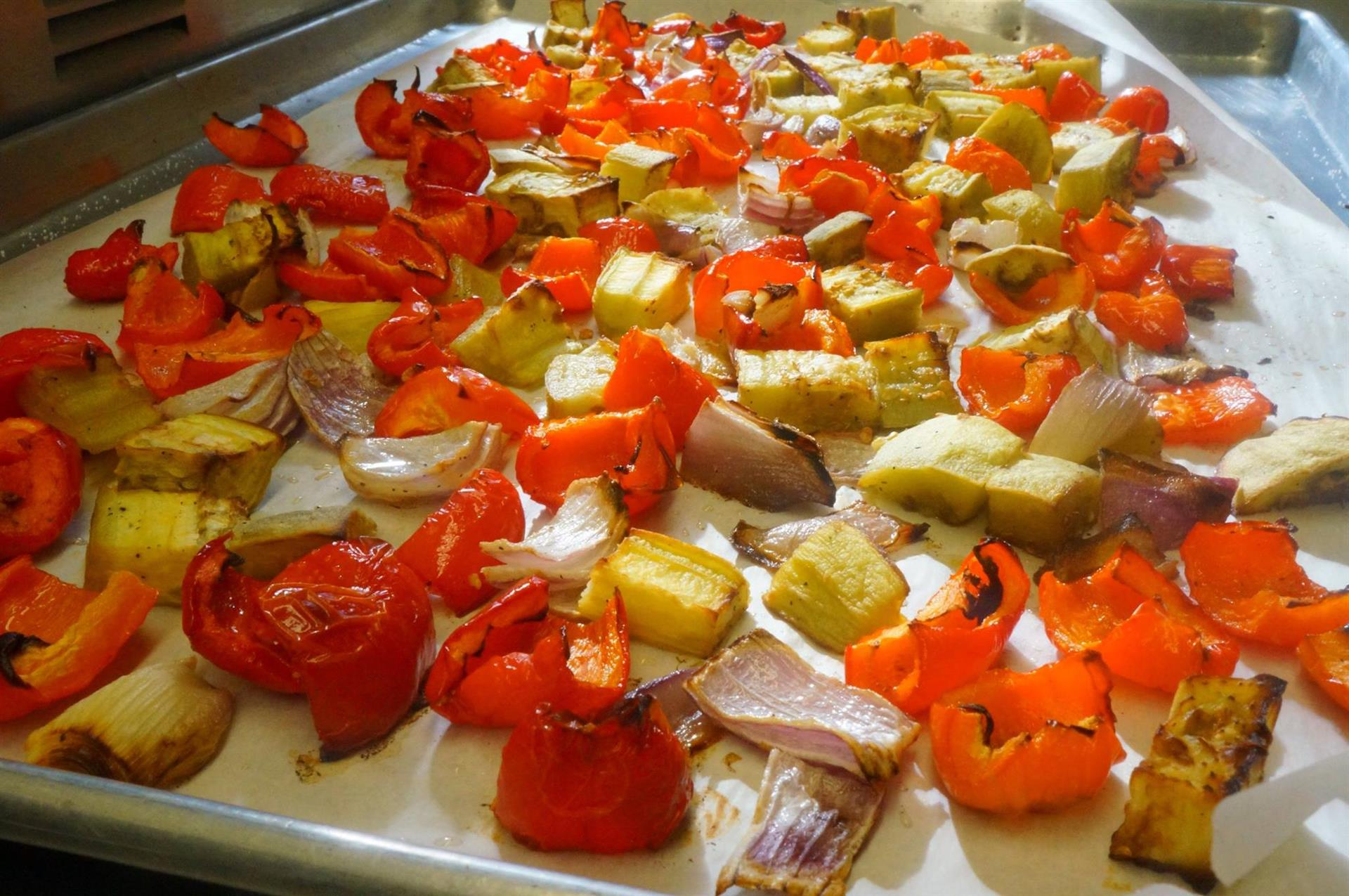 tray of onion, artichokes and bell peppers
