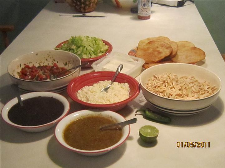 several bowls of food on a table