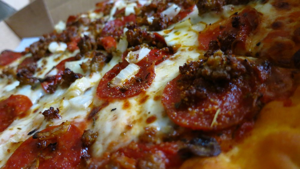 Closeup of the Combination pizza. Pepperoni, sausage, mushrooms, and onions.