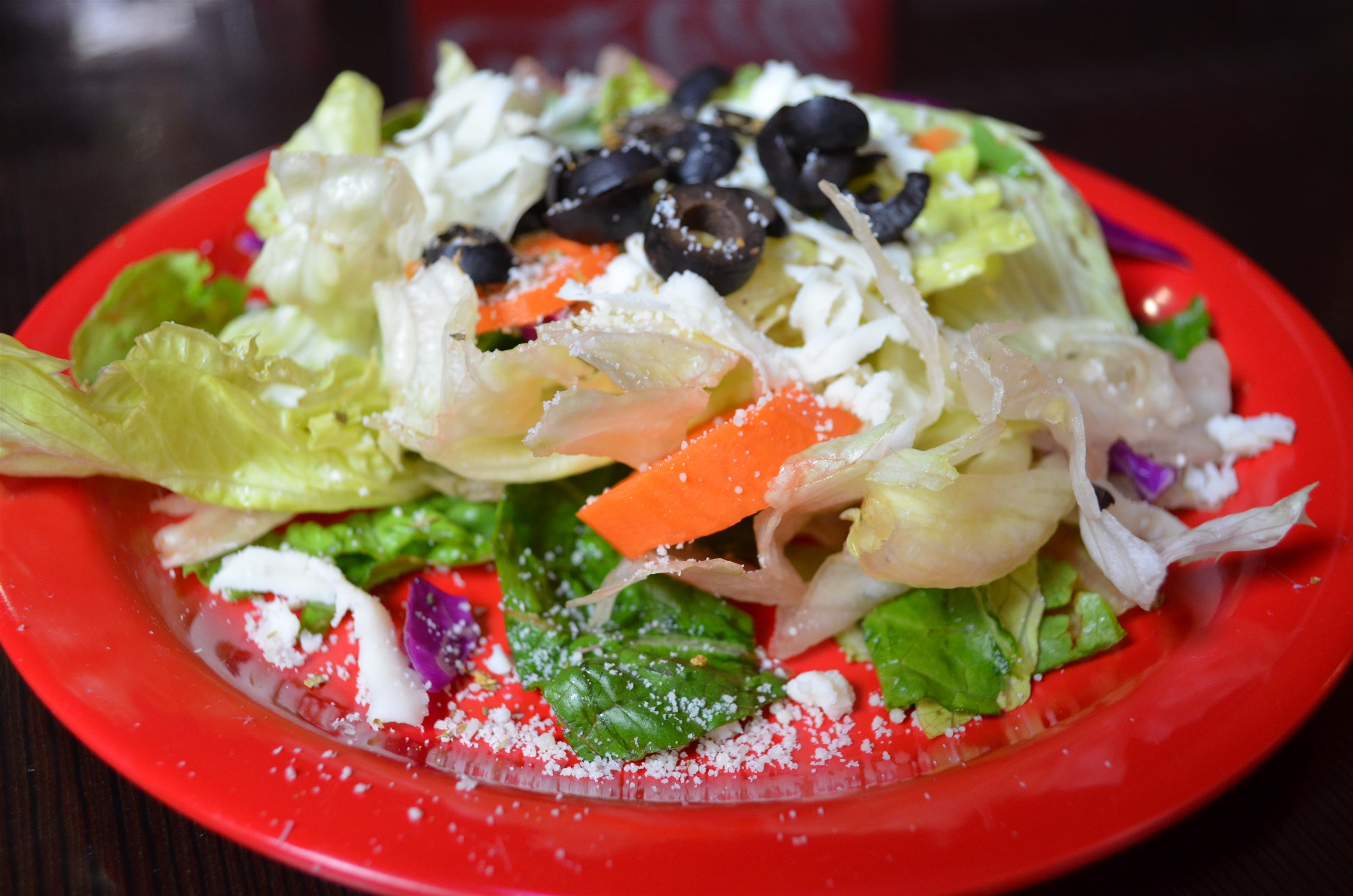 Dinner Salad. Iceberg lettuce, romaine, red cabbage, carrots, olives, and mozzarella cheese.