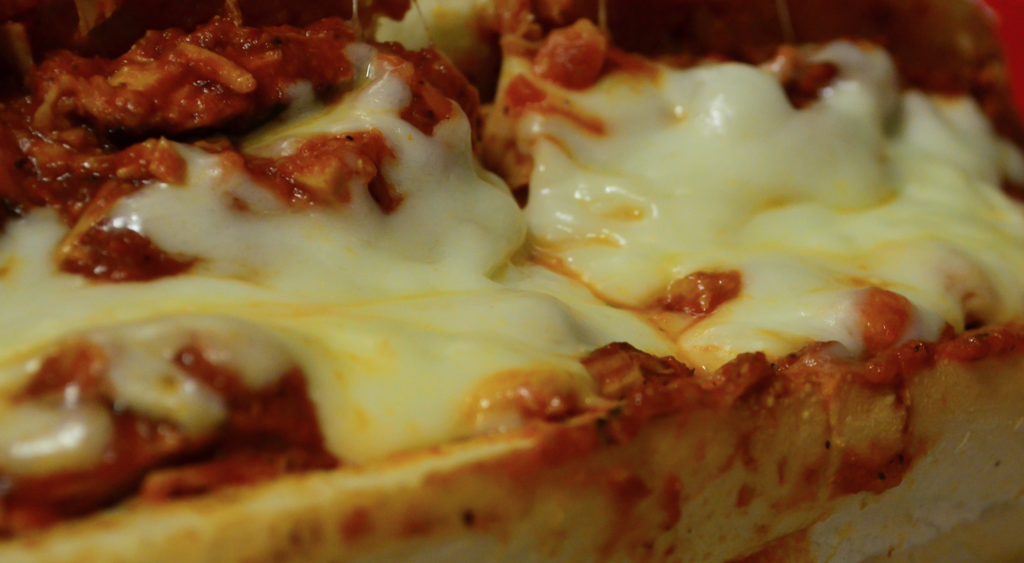 Closeup of a chicken parmesan hero.