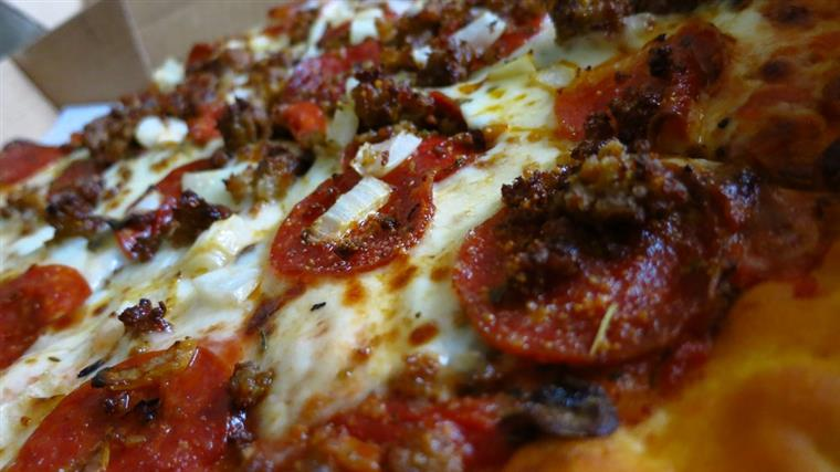 Closeup of pizza with pepperoni