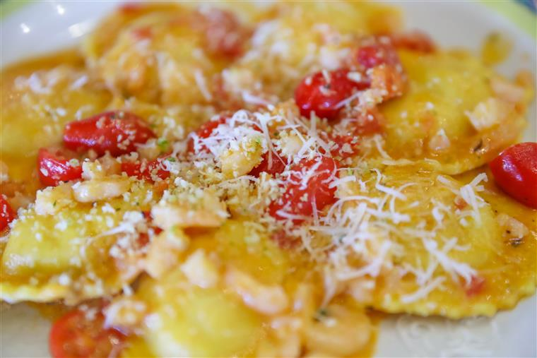 Delicious ravioli and cherry tomatoes on plate from above. lobster ravioli alla vodka.