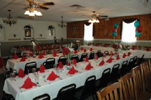 Dining area set up for a party with arranged Balloons and napkins