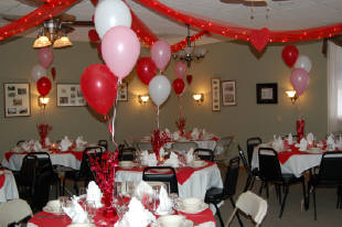 Dining area with balloons and ribbons for a event