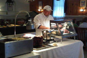 Chef preparing food behind a table
