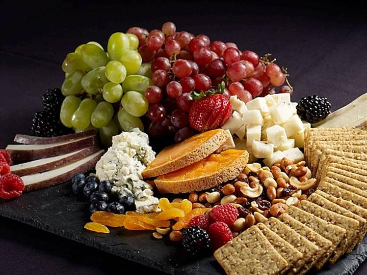 Assortment of Fruit, cheeses, nuts, and crackers