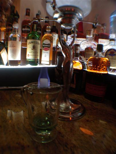 Bar counter with empty glass and glass sculpture