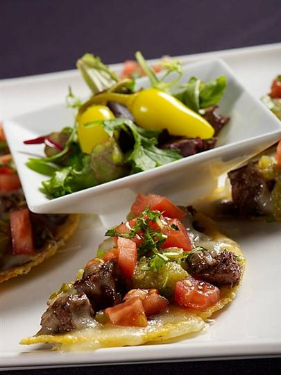 Salad with mini peppers served with mini steak hors d'oeuvres